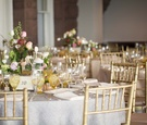 Wedding reception table with small arrangement of pink, white and green flowers