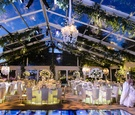 Bride and groom seeing plexiglas reception venue for first time