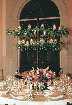 iron stands covered with vines suspended over table