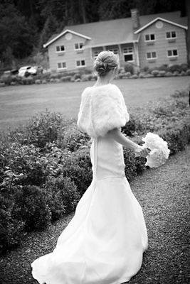 black and white bride wearing fit and flare gown and fur wrap