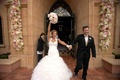 Bride and groom leaving hotel chapel