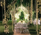 Outdoor cocktail hours with hanging white flower decorations