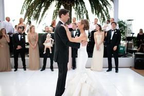 Bride and groom dancing on white tiled floor