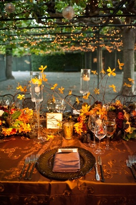 Metallic tablecloths and floating candle centerpieces