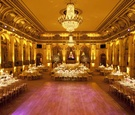 Ballroom wedding with gold details and chandelier