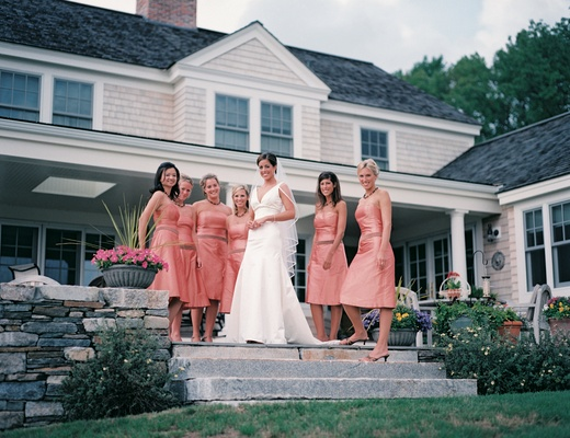 Bride and bridesmaids in front of Connecticut manor
