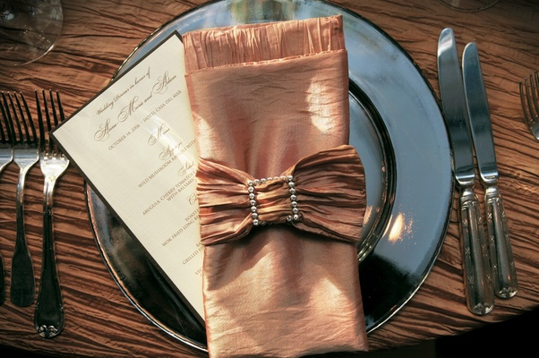 Tablescape with shiny charger plates and napkins