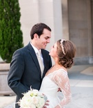 Bride in white dress with lace sleeves and groom in suit