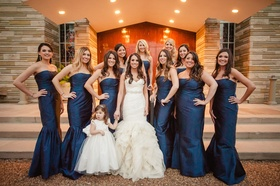 Bridesmaids wearing strapless mermaid-style dresses