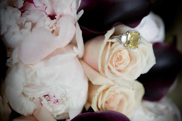 Three stone diamond engagement ring on peonies and roses