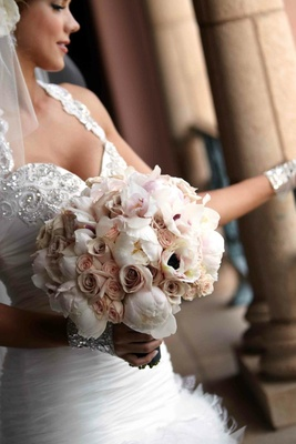 Jeweled bride holding rose and peony flowers