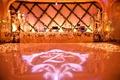 Gobo lighting display at festive ballroom reception