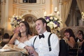 Bride with groom in a white shirt and black bow tie and suspenders