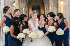 Bride and blue bridesmaids at Duke University Chapel