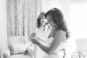 Black and white photo of mother-of-the-bride in suite