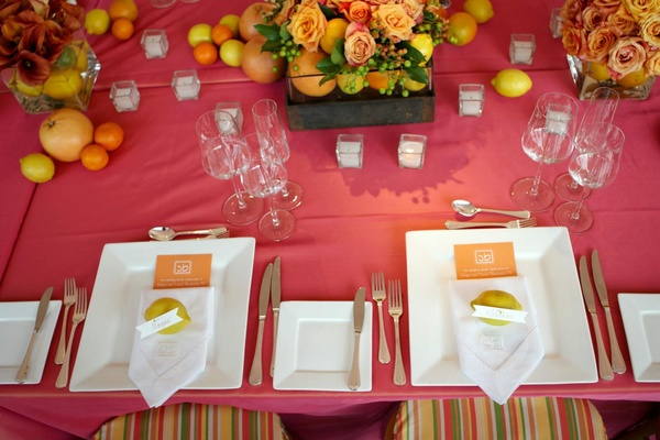 Hot pink wedding reception table with fruit centerpieces