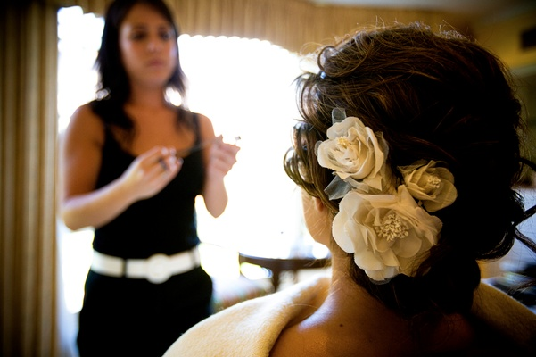 Silk flower hair accessory in bridal updo
