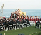 ceremony on lawn overlooking the ocean