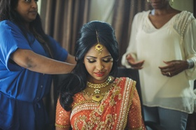 Indian bride wearing gold jewelry and eyeshadow
