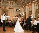 Bride in an A-line Romona Keveza gown dances with groom
