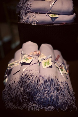 pashmina scarves rolled up as wedding favors