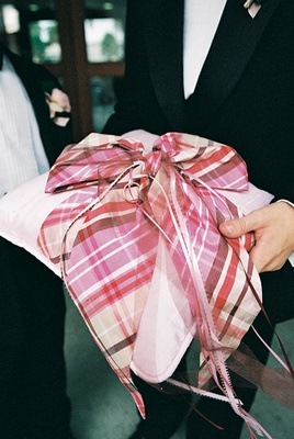 Plaid ribbon on top of light pink pillow