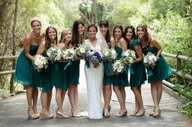 Melissa Claire Egan with bridesmaids in short emerald dresses