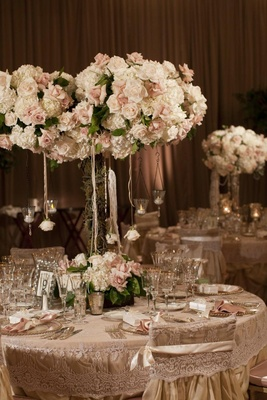 Lace table linens with tall floral centerpieces