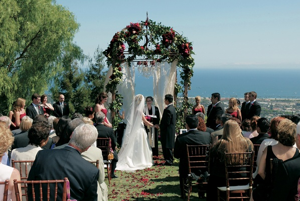 Ceremony structure covered with flowers and organza