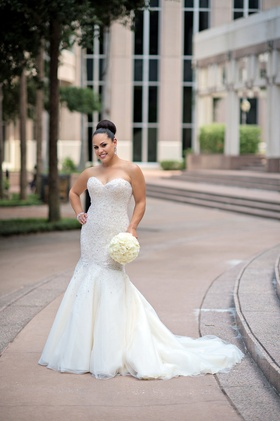 Bride holding bouquet wearing strapless bridal gown