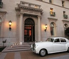 Vintage Rolls-Royce in front of The James Leary Flood Mansion