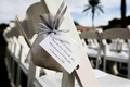 Silver organza bag tied to ceremony chairs