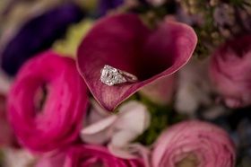 Princess cut diamond engagement ring on calla lily