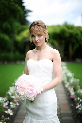 bride with strapless gown, pink bouquet and updo