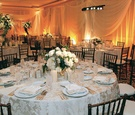Low white centerpieces and textured linens