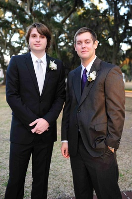 Groom with groomsman in purple tie and grey suit