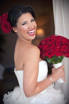 Red rose bouquet and dark red lipstick
