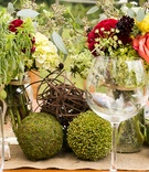 Moss balls and twig spheres at rustic bridal shower