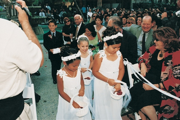 Flower girls and ring bearer walk down aisle