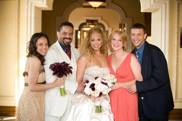 Bride with mixed race family at wedding