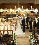 Father-of-the-Bride lifting veil at church wedding