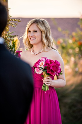 Blonde bridesmaid in strapless pink dress with peony and rose bouquet