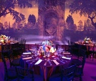 Garden backdrop and reception tables with purple lighting
