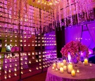 Mirror reception room with candle wall and orchids