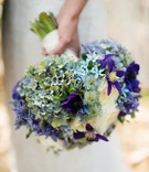 Melissa Claire Egan wedding bouquet with blue and purple flowers