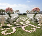 Resort lawn wedding with pink and white rose details