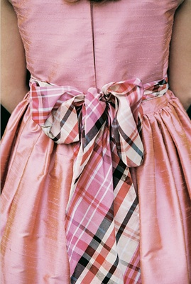 Pink dress with brown and red checkered ribbon
