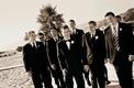 groomsmen on the sand at california beach