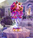 Wedding reception table with crystal candelabra and colorful orchids and roses