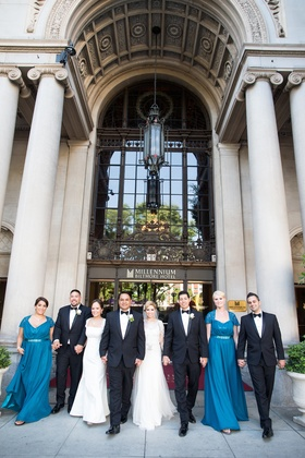 Bride in a Jenny Packham dress, groom and groomsmen in tuxedos, and bridesmaids in long blue dresses
